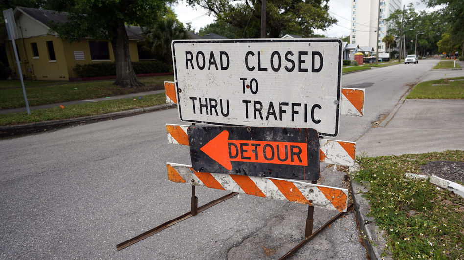 A city street is closed this month for repairs and upgrades in Orlando, Fla. As part of an infrastructure proposal by the Biden administration, $115 billion is earmarked to modernize bridges, highways and roads. (John Raoux/AP)