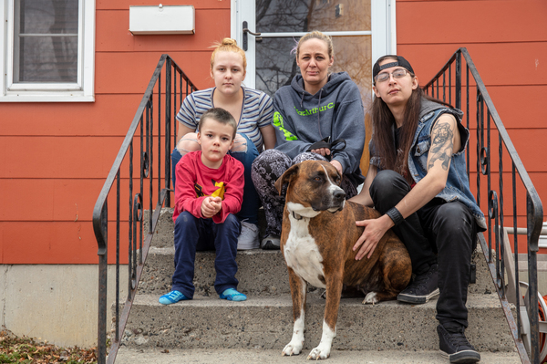 """Gaught sits outside the house she now rents in Billings with her three children. The family had to leave suddenly when they were evicted, and still haven't been able to find a cat they had at the mobile home park. """"We looked and called around forever and we just could never find her,"""" Gaught says. It was her 5-year-old son Blazen's (left) cat. """"And that was slightly devastating to him."""""""