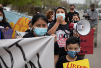 Sulma Franco, an organizer with Mujeres Luchadoras and Grassroots Leadership and an LGBT activist from Guatemala, leads protesters on March 24 to the entrance of the T. Don Hutto Residential Center in Taylor, Texas, where U.S. Immigration and Customs Enforcement contracts for the detention of migrant women.
