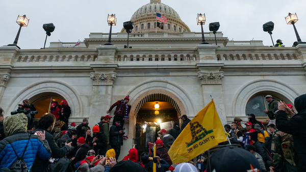 Rioters clash with law enforcement as they attempt to enter the U.S. Capitol building on Jan. 6.