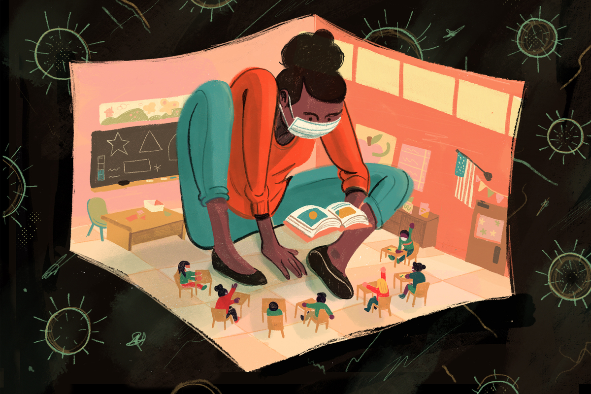 A masked teacher sits squeezed in a classroom with her students.