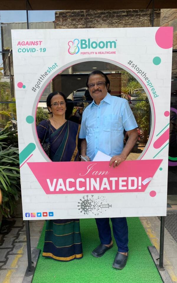 The author's parents, homemaker Ranee and movie house owner Chidambaram Valliappan posed at a vaccine selfie booth after getting their second doses in the southern Indian city of Chennai.