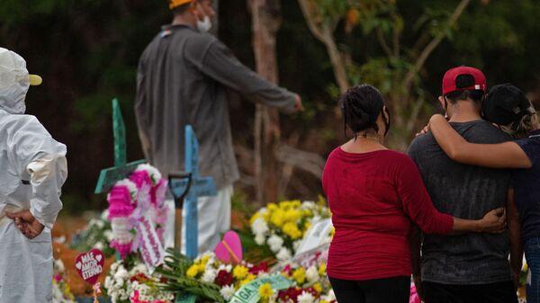 Relatives attend a COVID-19 victim