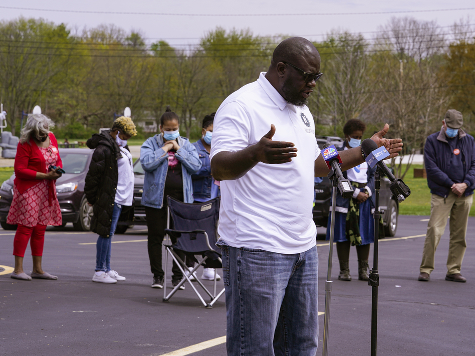 Pastor Denell Howard leads a prayer Saturday at a vigil at Olivet Missionary Baptist Church in Indianapolis for the victims of the shooting Thursday at a FedEx facility. (Michael Conroy/AP)