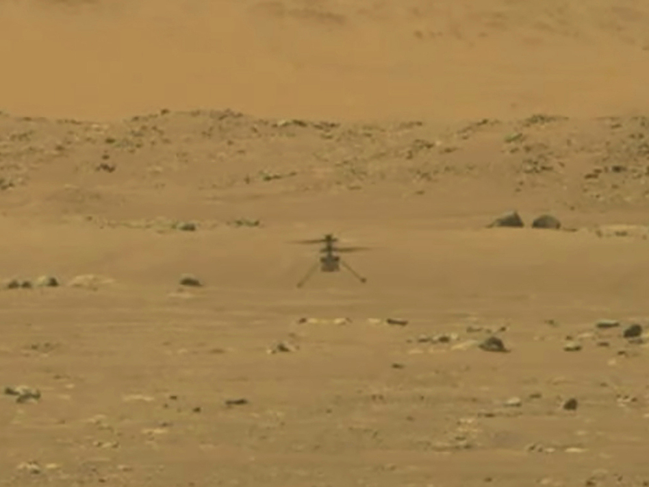 NASA's 4-pound, experimental helicopter Ingenuity lands on the surface of Mars on Monday. (NASA via AP)