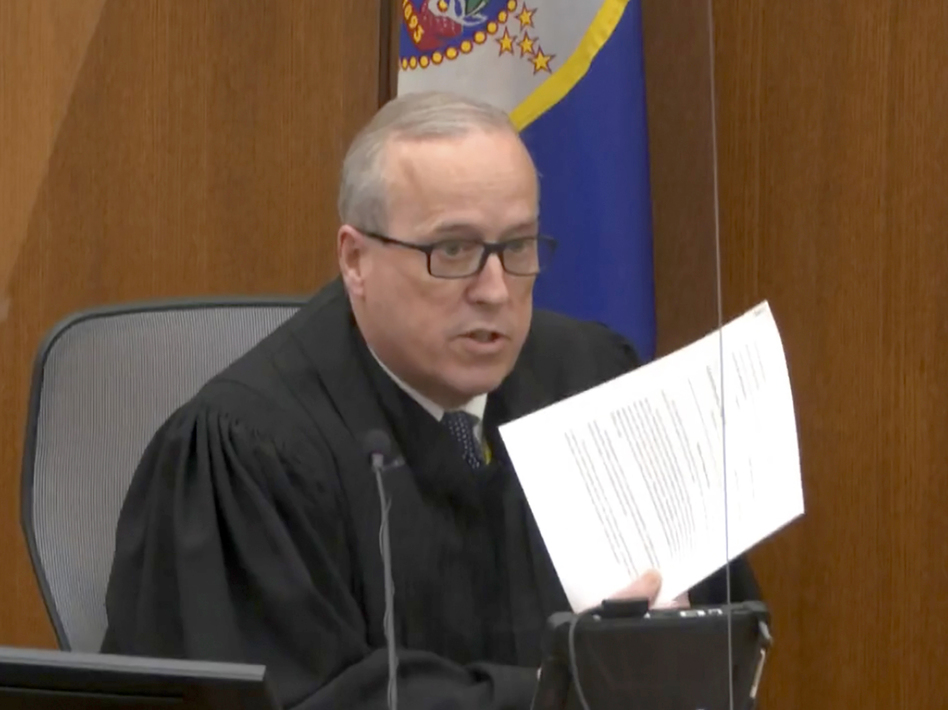 In an image taken from video on Monday, Hennepin County Judge Peter Cahill reads instructions to the jury before closing arguments in the trial of former Minneapolis police officer Derek Chauvin. (AP)