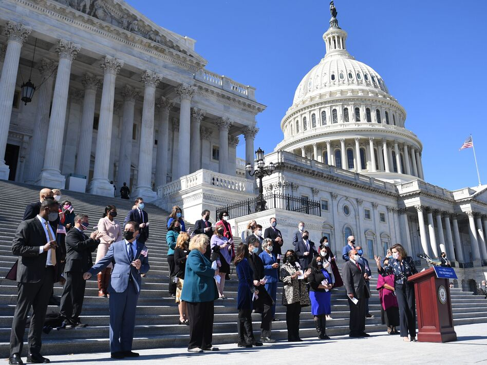 House Speaker Nancy Pelosi (right) speaks outside the U.S. Capitol in March with other members of the U.S. House of Representatives, the size of which has stayed at 435 voting members for decades. (Eric Baradat/AFP via Getty Images)