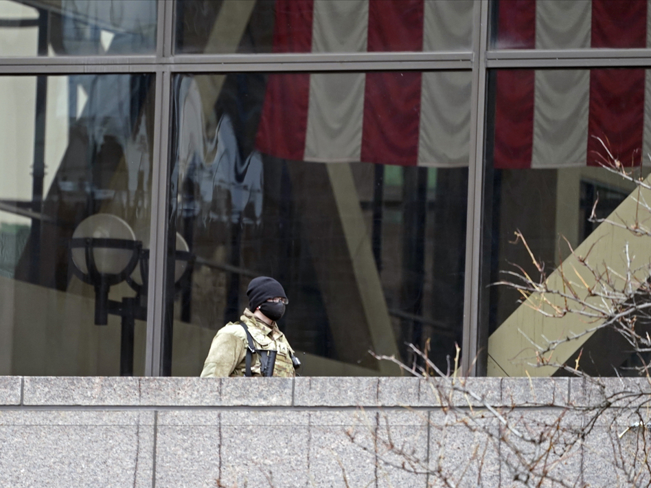 A National Guard soldier stands guard on an outside balcony last week at the Hennepin County Government Center in Minneapolis, where the trial of former police officer Derek Chauvin in the death of George Floyd continues. (Jim Mone/AP)