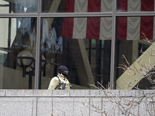 A National Guard soldier stands on an outside balcony at the Hennepin County Government Center last week in Minneapolis where the trial of former police officer Derek Chauvin for the death of George Floyd continues.