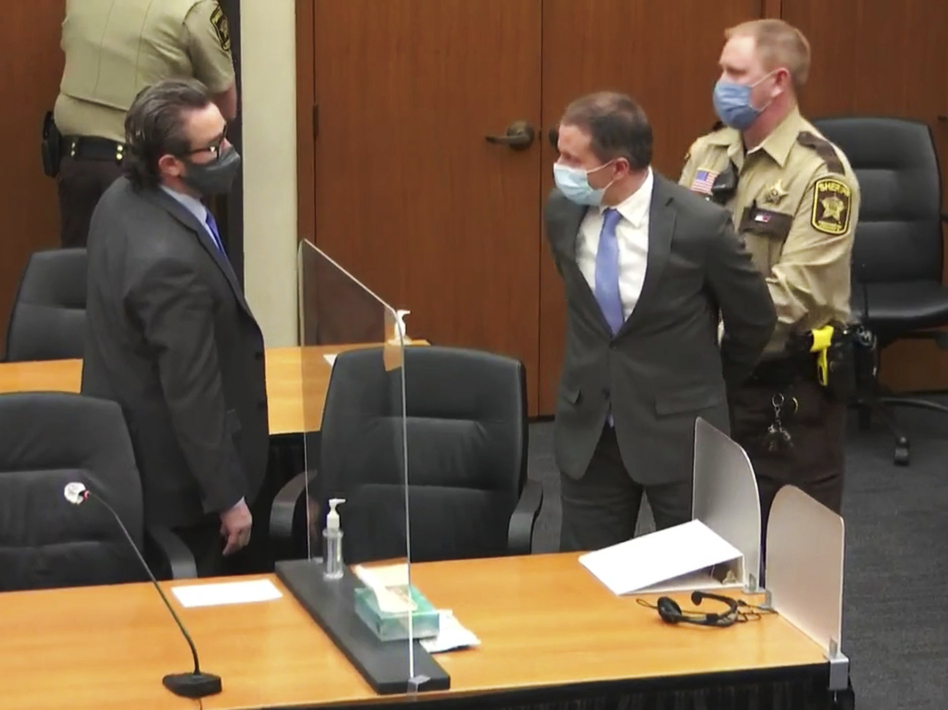 Former Minneapolis police officer Derek Chauvin is taken into custody as his attorney, Eric Nelson, looks on after the verdicts were read on Tuesday at Chauvin's trial for the 2020 death of George Floyd. (Court TV/AP)