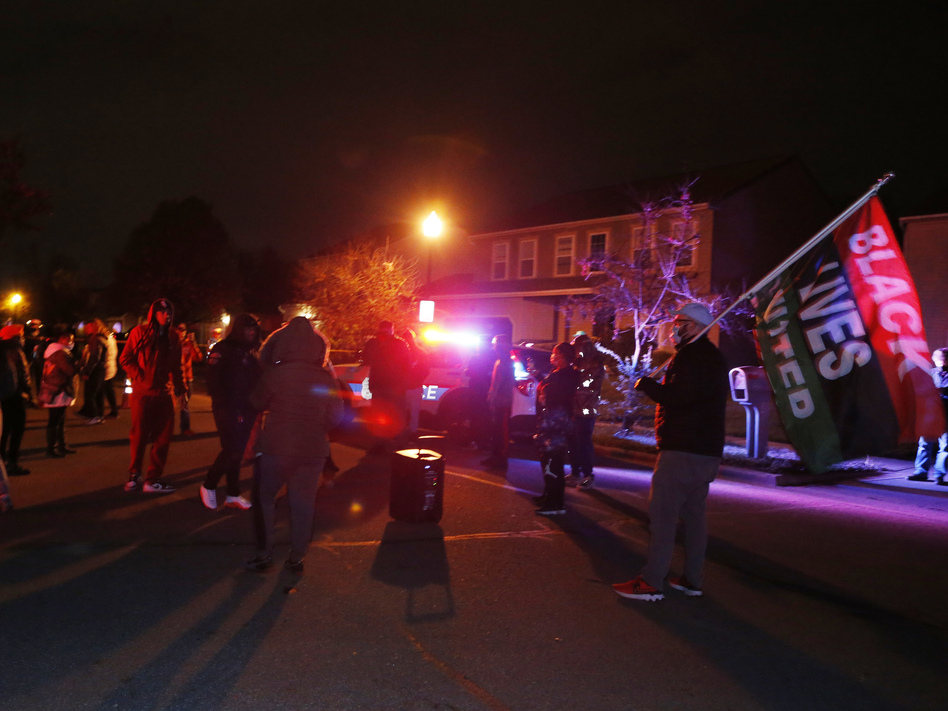 A crowd gathers to protest in the neighborhood where a police officer fatally shot a teenage girl on Tuesday in Columbus, Ohio. (Jay LaPrete/AP)