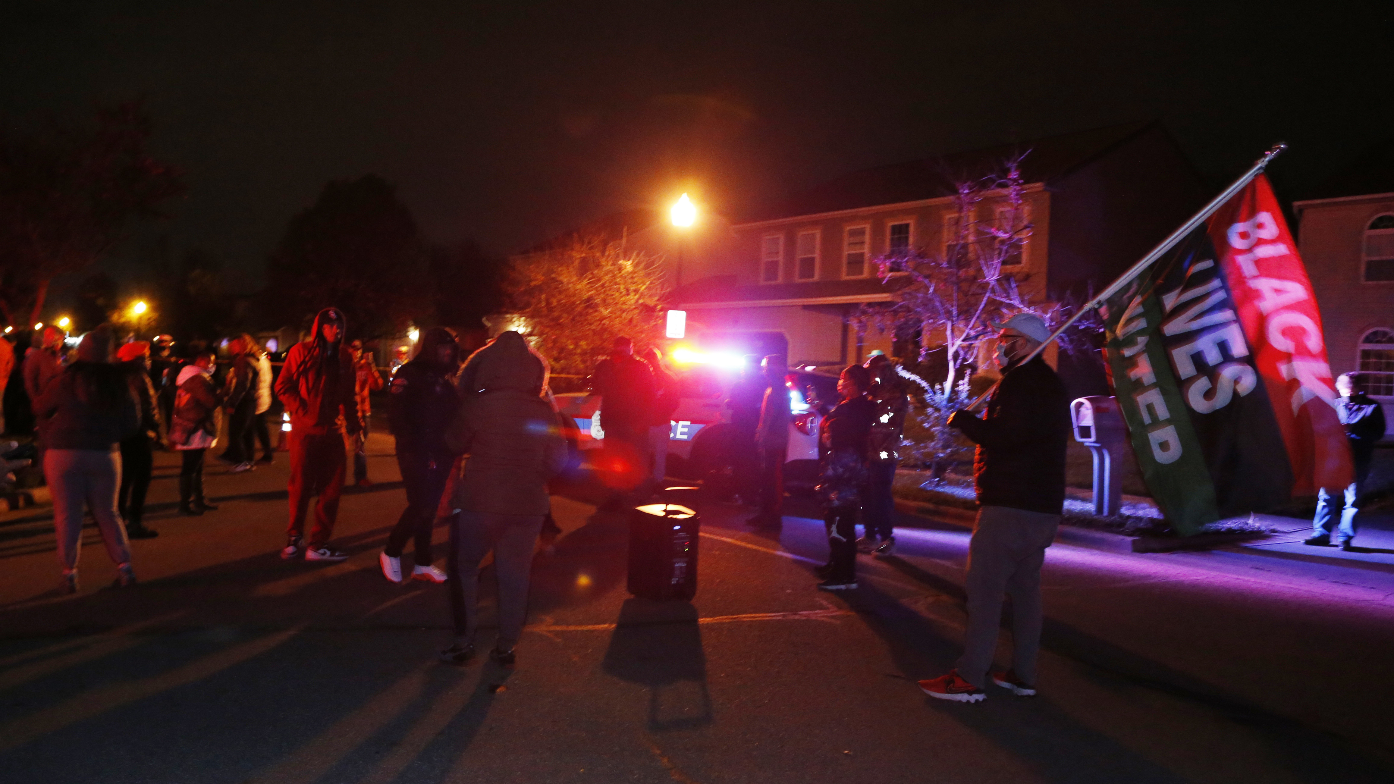 A crowd gathers to protest in the neighborhood where a police officer fatally shot a teenage girl on Tuesday in Columbus, Ohio.