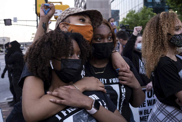 Chiara Campbell, from left, Nyasia Thompson and Jaylah Lesesne embrace following a march through downtown Atlanta after Derek Chauvin was found guilty.