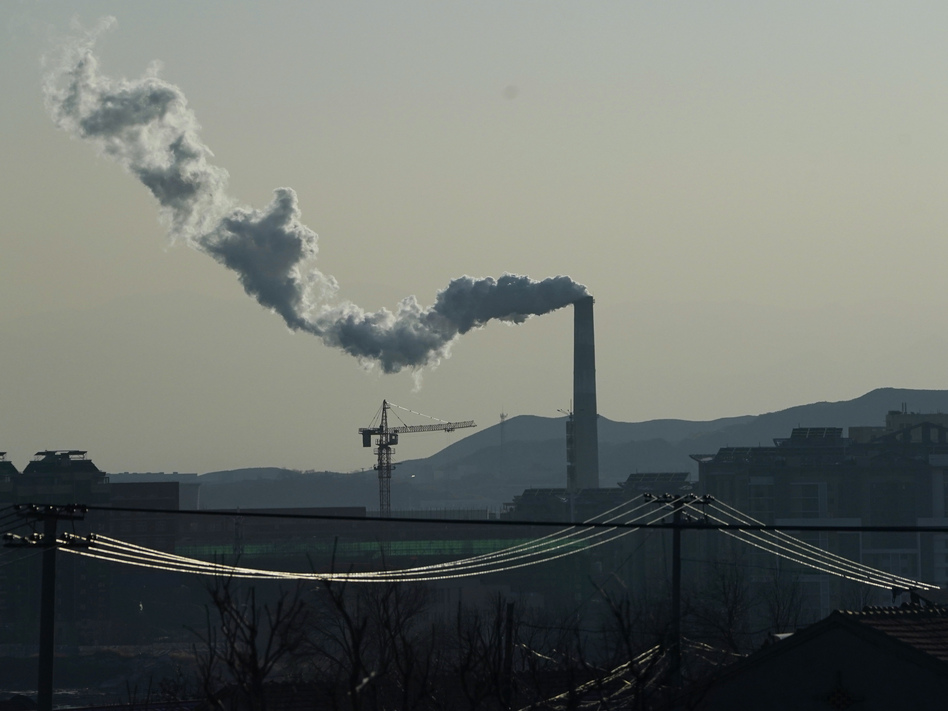 Smoke comes out of a chimney in northwestern China's Hebei province on Dec. 15, 2020. Chinese President Xi Jinping made a pledge at a United Nations meeting in September that China would go carbon neutral by 2060.