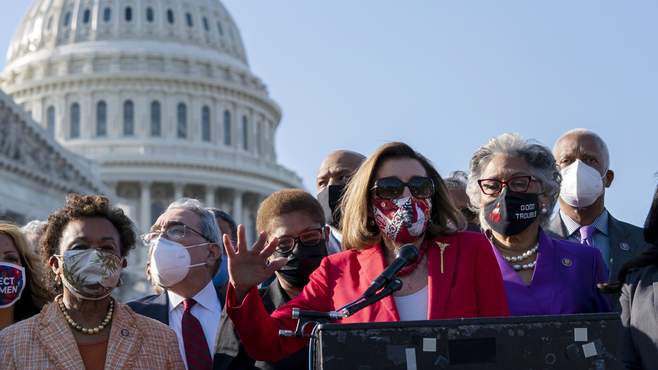 House Speaker Nancy Pelosi speaks alongside members of the Congressional Black Caucus on Tuesday following the verdict against former Minneapolis police officer Derek Chauvin for the murder of George Floyd. (Jose Luis Magana/AP)
