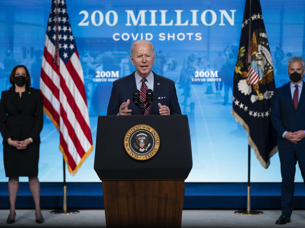 President Biden appears Wednesday at the White House, where he announced his administration has reached a goal of 200 million COVID-19 shots within his first 100 days in office.