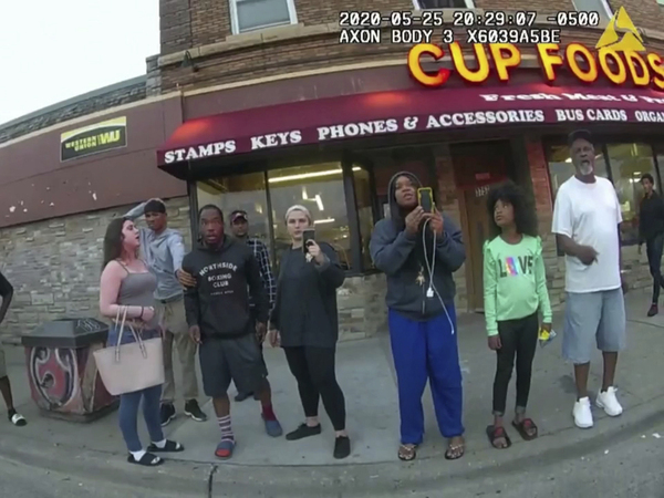 An image from a police body camera shows bystanders outside Cup Foods in Minneapolis on May 25, 2020. The group includes Darnella Frazier, third from right, as she made a 10-minute recording of George Floyd's death.