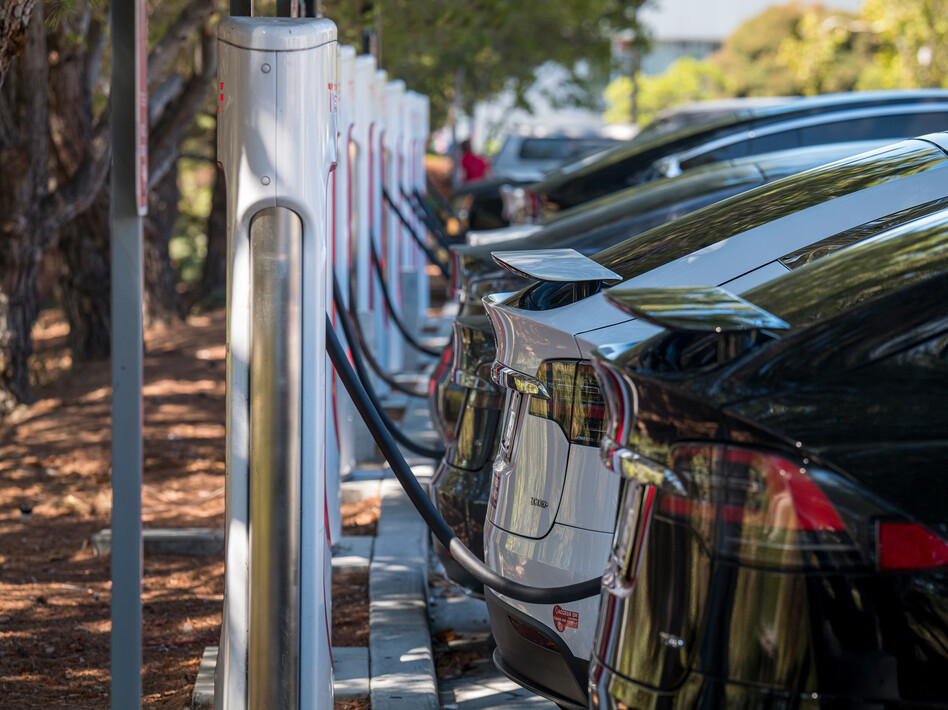 Electric vehicles at a charging station last year in San Mateo, Calif. The governors of 12 states, including California, have called on President Biden to order that all cars and light trucks sold in the U.S. after 2035 be zero-emission vehicles. (David Paul Morris/Bloomberg via Getty Images)