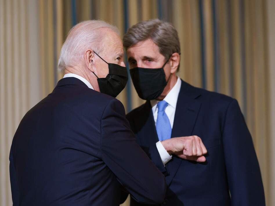 President Biden greets Special Presidential Envoy for Climate John Kerry in January.