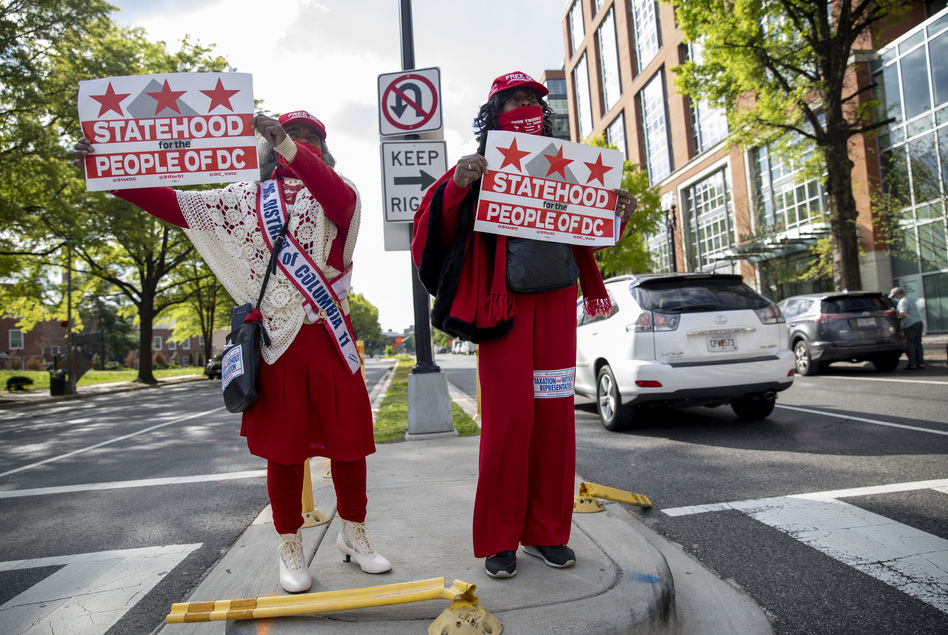 In Ward 6 at Maine Ave SW in front of The Wharf, Emma P. Ward, left, (Ms. Senior District of Columbia 2011) and Joyce Robinson-Paul show their support for D.C. statehood.