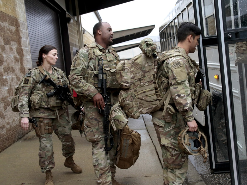 U.S. Army soldiers board a bus in January 2020 at Fort Bragg, N.C., one of the military bases that will likely see population boosts in their 2020 census counts due to a change to how troops deployed abroad were counted. (Chris Seward/AP)