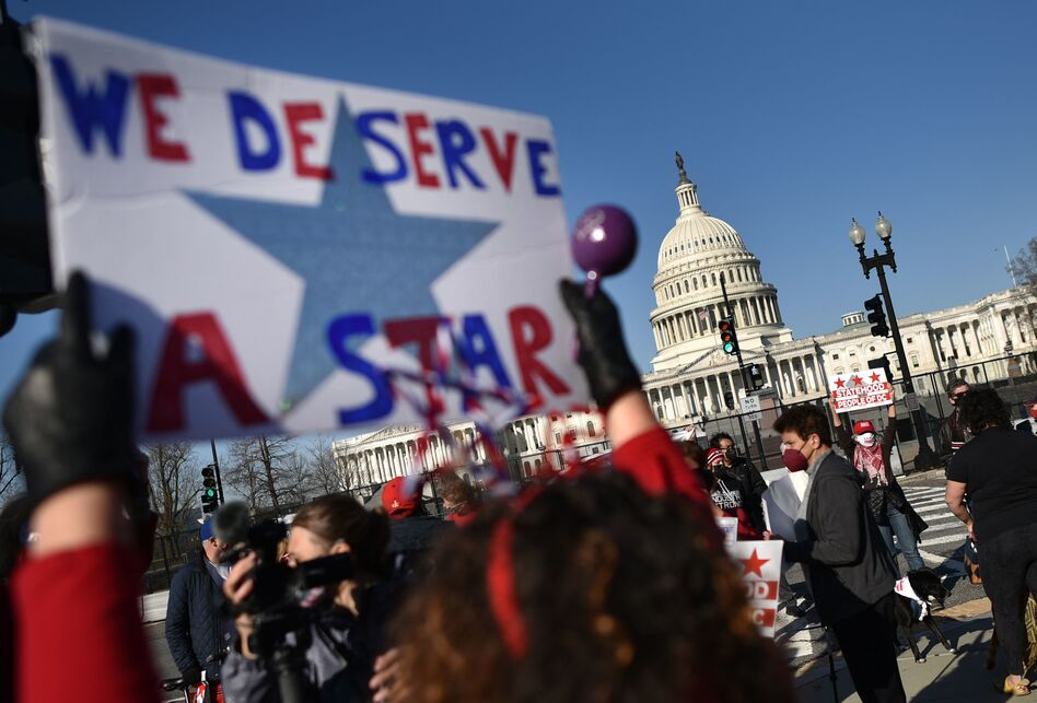 Activists take part in a March rally near the U.S. Capitol in support of statehood for Washington, D.C. One month later, the House of Representatives passed a bill 216-208 that would make D.C. the nation's 51st state.