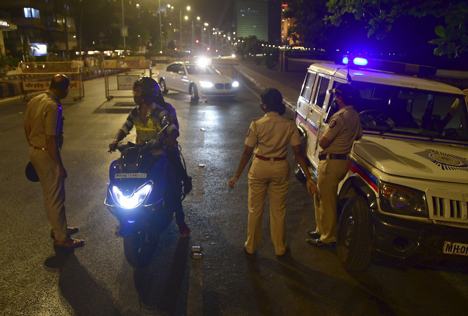 Police check commuters in Mumbai during a planned 15-day lockdown that began on April 14, closing all businesses, services, activities and public places except those deemed essential.