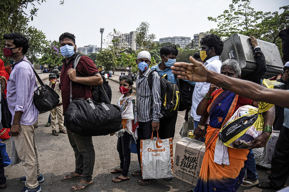 Migrant workers line up to enter a railway station in Mumbai on April 14 hoping to leave the city ahead of a lockdown.