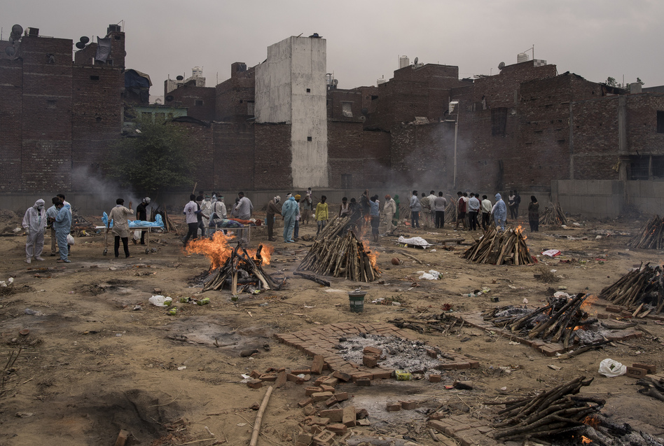Funeral pyres for patients who died of COVID-19 are seen burning this week at a makeshift crematorium in New Delhi.