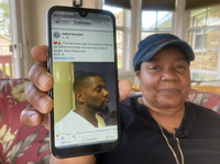 Glenda Brown Thomas displays a photo of her nephew, Andrew Brown Jr., on Thursday. He was shot and killed Wednesday by a sheriff's deputy who was attempting to execute a warrant.