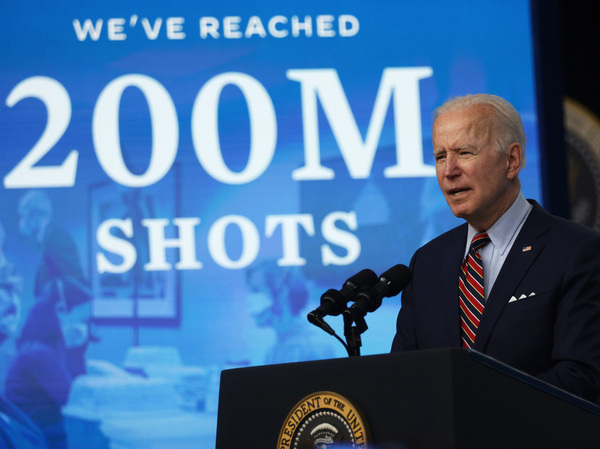 President Biden marks hitting a goal of 200 million shots in arms by his 100th day in office during remarks at the Eisenhower Executive Office Building on April 21.