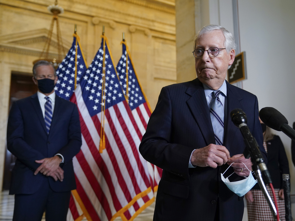 Senate Minority Leader Mitch McConnell, R-Ky., joined by Senate Minority Whip John Thune, R-S.D., left, has argued that President Biden is not governing like the moderate he campaigned as in 2020. (J. Scott Applewhite/AP)
