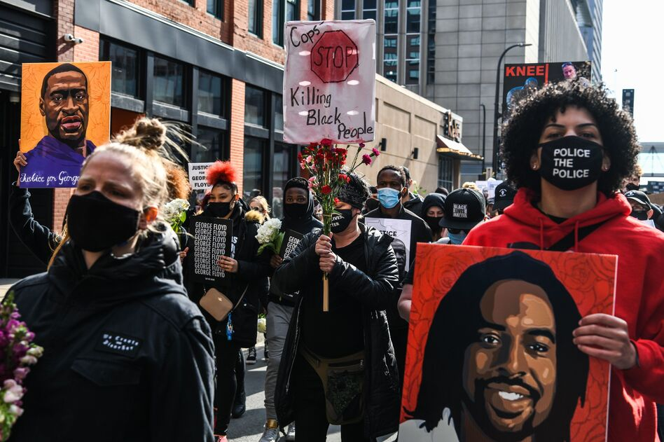 Demonstrators in Minneapolis ahead of the trial of former police officer Derek Chauvin, who has since been convicted of murdering George Floyd. (Chandan Khanna/AFP via Getty Images)