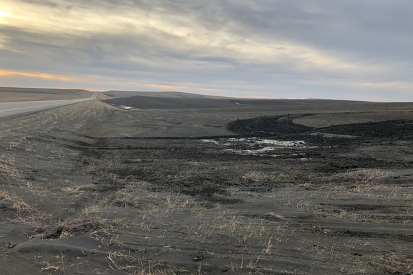 In early March, wind-blown soil filled a ditch between a road and the fields of Gunsmoke Farms.