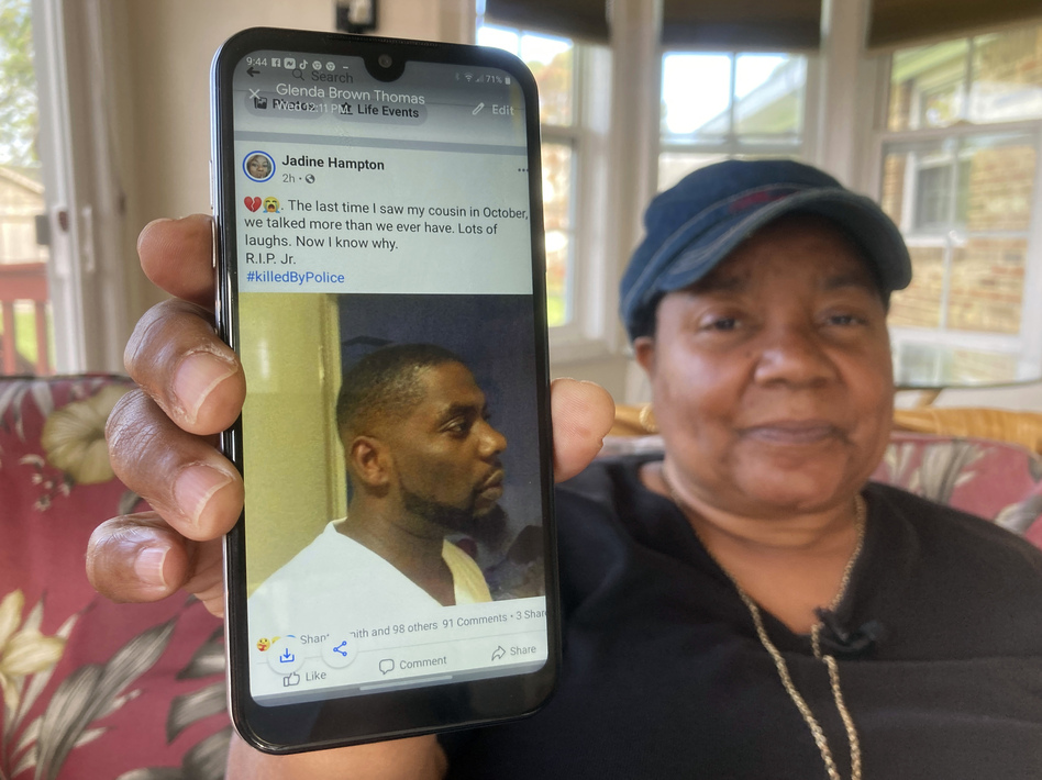 Glenda Brown Thomas displays a photo of her nephew, Andrew Brown Jr., on her cellphone at her home last week in Elizabeth City, N.C. Brown was shot and killed by sheriff's deputies attempting to execute a warrant. (Allen G. Breed/AP)
