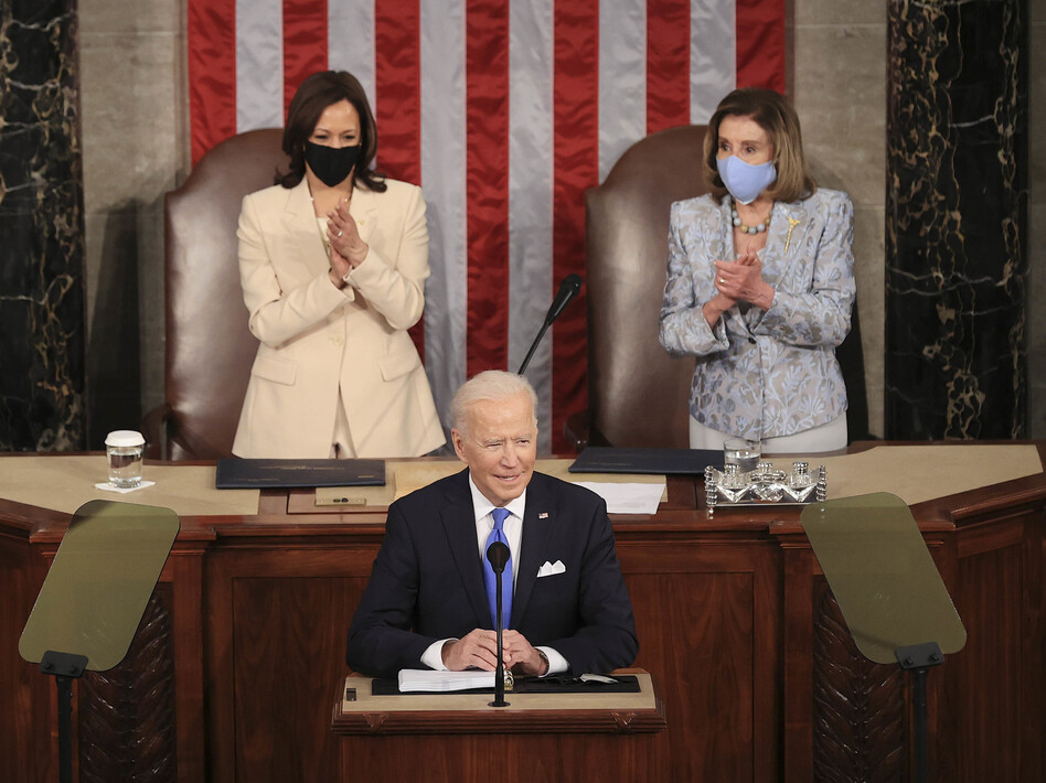 In a historic first, President Biden was flanked by two women — House Speaker Nancy Pelosi and Vice President Harris — as he addressed a joint session of Congress at the U.S. Capitol on Wednesday. (Chip Somodevilla/Bloomberg via Getty Images)