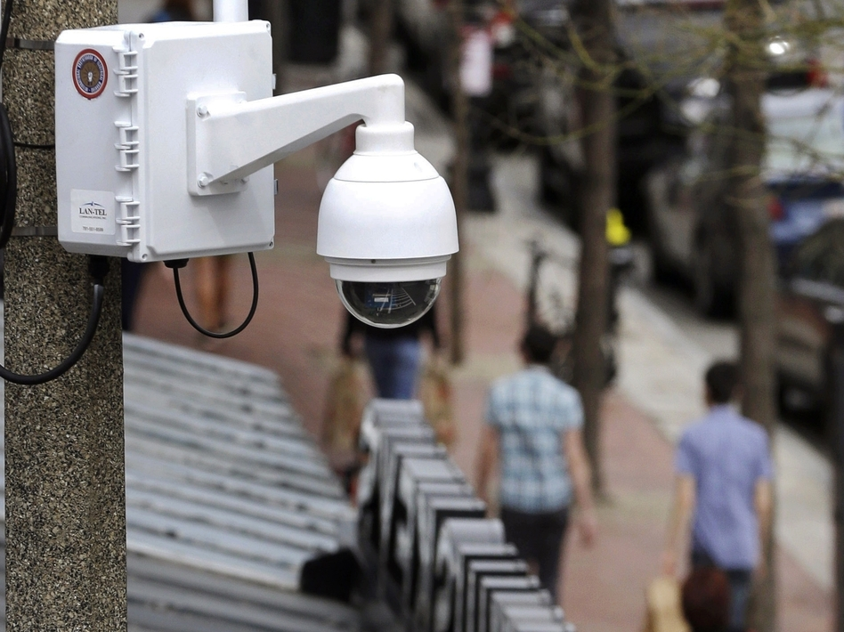 Surveillance cameras, like the one here in Boston, are used throughout Massachusetts. The state now regulates how police use facial recognition technology. (Steven Senne/AP)