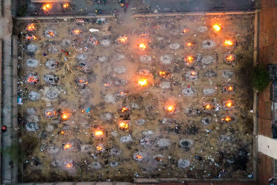 Victims of COVID-19 are cremated in funeral pyres this week in New Delhi. Scientists says the real death toll and number of infections are likely much higher than what the Indian government is reporting. (Jewel Samad/AFP via Getty Images)