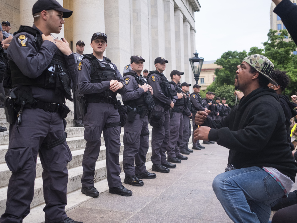 Protesters chant for Ohio state troopers and Columbus police to take a knee with them in solidarity on the Ohio Statehouse steps on June 1, 2020, in Columbus. A federal judge has ordered Columbus police to stop using force against nonviolent protesters. (Matthew Hatcher/Getty Images)