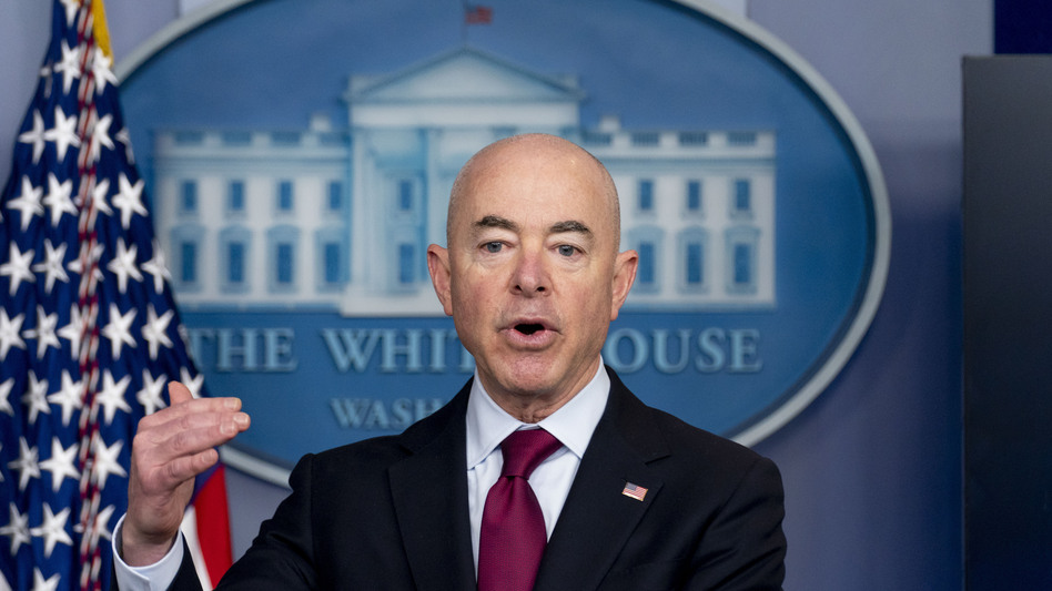 """Homeland Security Secretary Alejandro Mayorkas speaks during a March 1 news conference at the White House. The Biden administration says four families that were separated at the Mexico border during the Trump administration would be reunited in the U.S. during the first week of May. It's the first of what Mayorkas calls """"just the beginning"""" of a broader effort. (Andrew Harnik/AP)"""