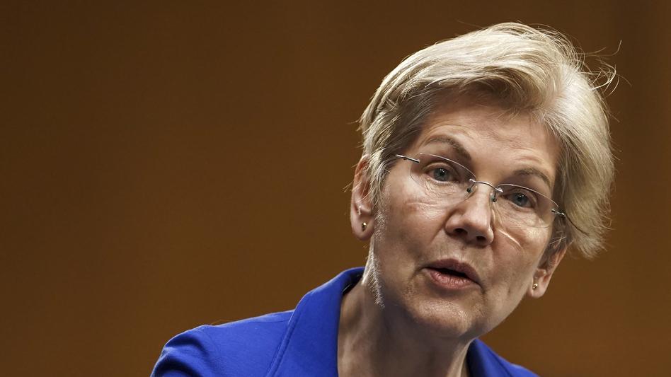 Sen. Elizabeth Warren speaks during a Senate Finance Committee hearing in Washington on Feb. 24. Warren's latest book is called <em>Persist</em>. (Greg Nash/AP)