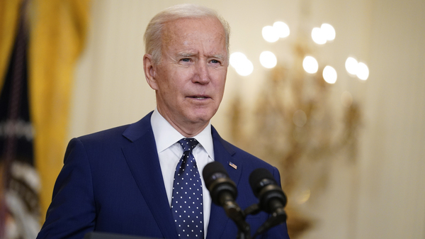 President Biden, pictured in the East Room of the White House on April 15, announced Monday that the administration is lifting the ceiling on the number of refugees who can be admitted into the country this fiscal year.