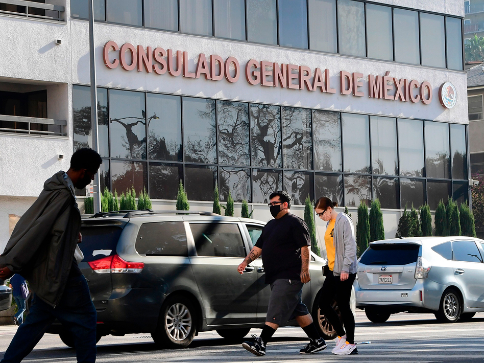 Pedestrians walk past Mexico's Consulate General in Los Angeles in October, shortly after ex-Mexican Defense Secretary Salvador Cienfuegos Zepeda's arrest at Los Angeles International Airport at the DEA's request. Charges were later dropped. (Frederic J. Brown/AFP via Getty Images)