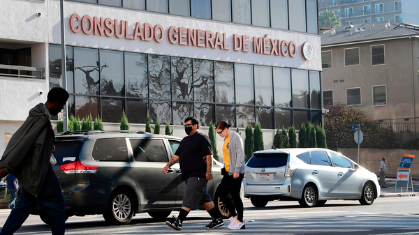 Pedestrians walk past the Consulate General of Mexico in Los Angeles, California on October 16, 2020, a day after former Mexican Secretary of Defense Salvador Cienfuegos was arrested at Los Angeles International Airport at the request of the U.S. Drug Enforcement Administration.