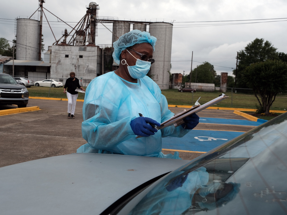Medical workers with Delta Health Center prepare to vaccinate people in Leland, Miss., last week. In some places, rural hospital workers have been slow to get the vaccine themselves. (Spencer Platt/Getty Images)