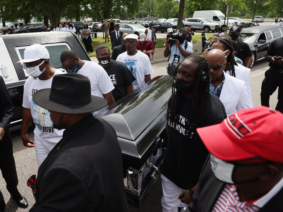 Pallbearers carry Brown's casket to a horse-drawn carriage before his funeral service Monday at the Fountain of Life Church in Elizabeth City, N.C. (Joe Raedle/Getty Images)