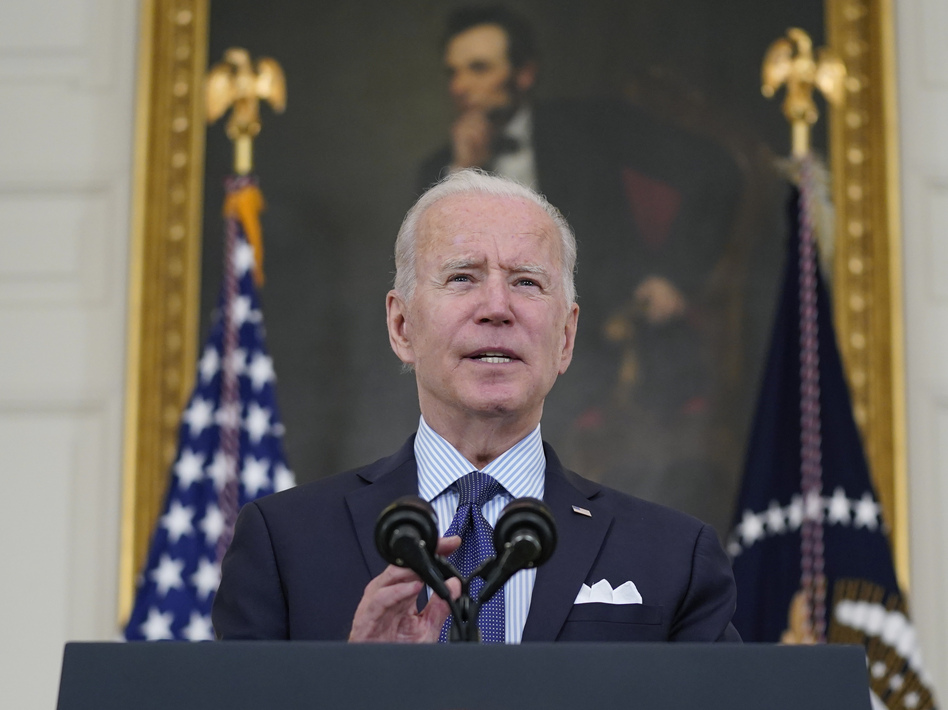 President Biden speaks about the COVID-19 vaccination program Tuesday in the White House. Biden has set a goal of seeing 160 million adults fully vaccinated by July Fourth. (Evan Vucci/AP)