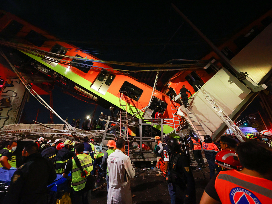 Emergency personnel search for survivors after a raised subway track collapsed Monday night in Mexico City. (Hector Vivas/Getty Images)