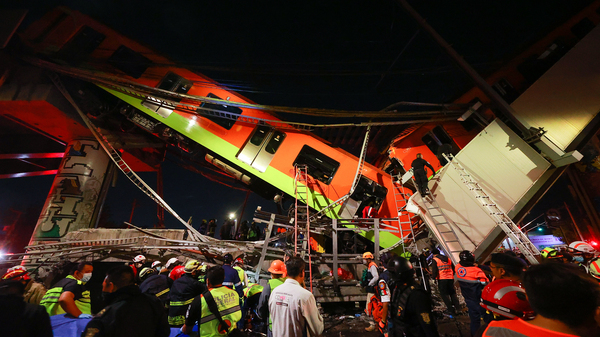 Emergency personnel work to search for accident survivors after a raised subway track collapsed Monday night in Mexico City, Mexico.