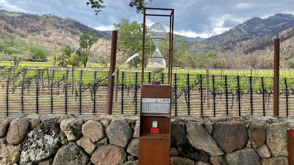 The entrance to Hourglass winery, with an evacuation tag from the Napa County Sheriff's Office from last year's Glass Fire blowing in the wind. Residents place these tags on their properties before evacuating, easing the job of first responders.